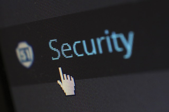 mouse clicking the word Security on a screen